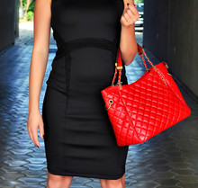 Sophisticated, Elegant Woman In Little Black Dress, Holding Leather Red Handbag With Golden Details. Black And Red Combination For Every Occasion