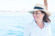 canvas print picture - Beautiful middle age woman traveling on sailboat and smiling happy and confident.