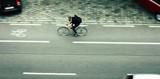 Man cycling on city street - 211292394