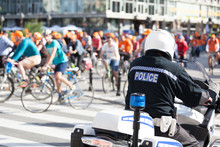 Police Officer On Duty Guarding Cyclists