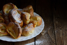 Yorkshire Puddings With Sugar Powder On A White Plate On A Wooden Table. Rustic Style. Copy Space.