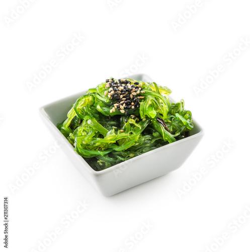 Wakame salad with seaweed and sesame seeds.