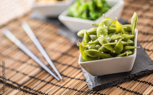Japanese asian food edamame nibbles, boiled green soy beans.