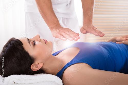 Woman Having Reiki Healing Treatment Canvas Print