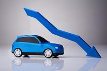 Declining Arrow Over Blue Car