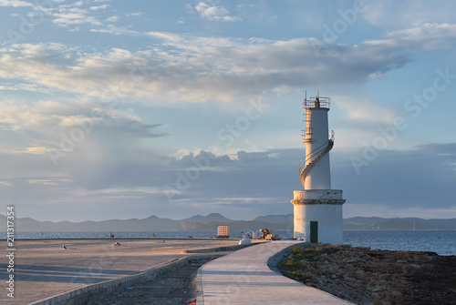 La Savina lighthouse in the port of Formentera at sunset. Spain