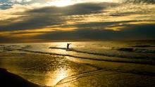 Silhouette Of Surf Fisherman At Sunrise On Hilton Head Island, SC