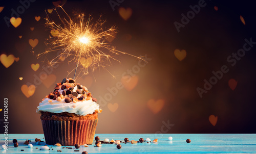 Obraz Chocolate Cupcake With Sparkler And Hearts Of Lights