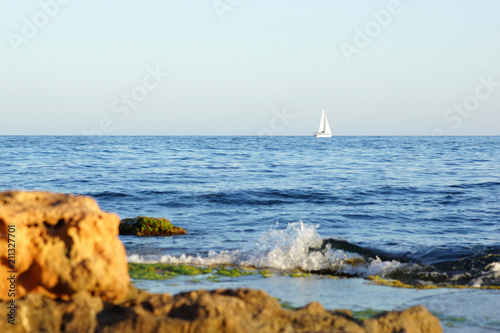 Mediterranean sea and sail of yacht on spanish seaside. Torrevieja, Spain.