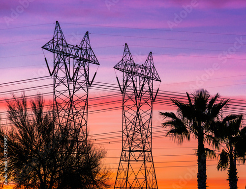 Silhouette of high voltage lines and transmission towers thru the desert at sunset Canvas-taulu