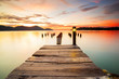 Beautiful view of sunset at Marina Island Old Jetty,Malaysia. soft focus, blur due to long exposure. Visible noise due to high ISO.