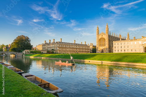 Beautiful view of college in Cambridge with people punting on river cam Wallpaper Mural