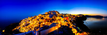 Oia Village View Illuminated With Lights Before Sunrise