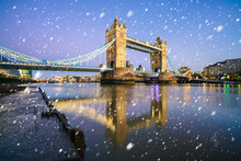 Tower Bridge With Falling Snow. Winter  In London
