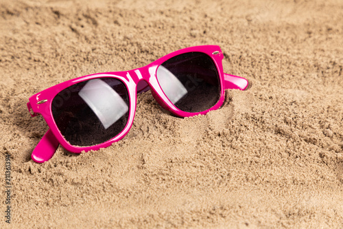 Papiers peints Inde sunglasses in sand at a beach
