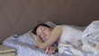 Beautiful woman who does not sleep wakes up in bed