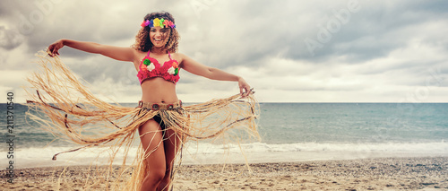 Beautiful and happy hawaiian woman portrait dancing on the beach, letterbox