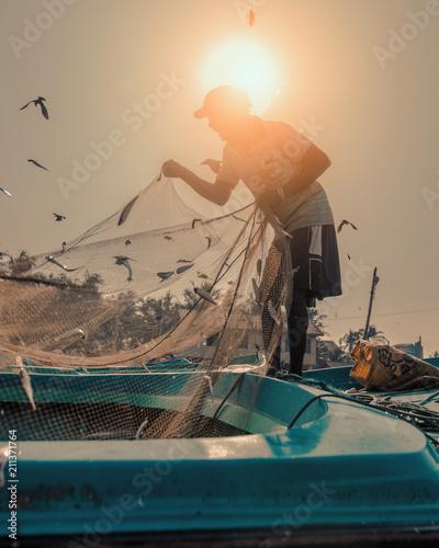 Fotografie, Obraz Silhouette of a fisherman in Sri Lanka
