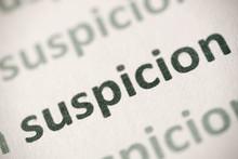Word Suspicion Printed On Pape...