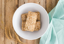 Wheat Biscuit Cereal In Bowl On Rustic Wooden Table, Top View Photo