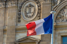 French Flag Waving In Front Of...