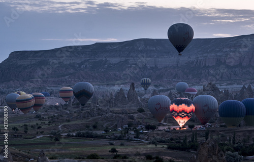 Obraz The great tourist attraction of Cappadocia - balloon flight on Sunrise. Cappadocia is known around the world as one of the best places to fly with hot air balloons. - fototapety do salonu