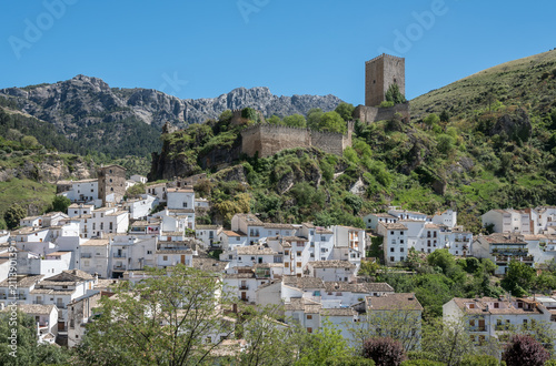 Picturesque town Cazorla with moorish fortress tower La Yerda and typical white houses surrounded by mountain range Sierra de Cazorla. Andalusia, Spain