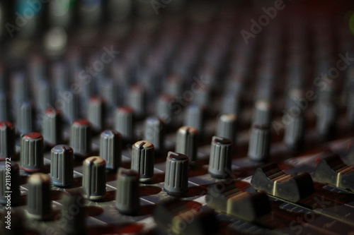 Foto op Canvas Begraafplaats close up view of knobs and sliders of light and sound board console at a concert theater