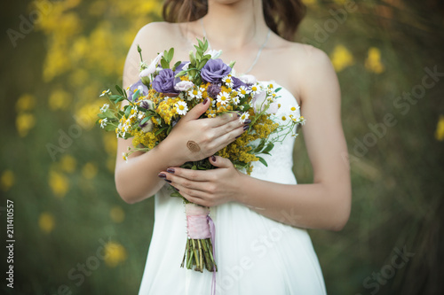 Leinwand Poster Wedding details, fashion bridal bouquet in hands of bride