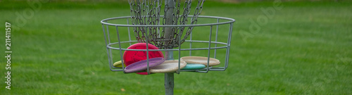 Fototapeta Disc Golf basket full of disc