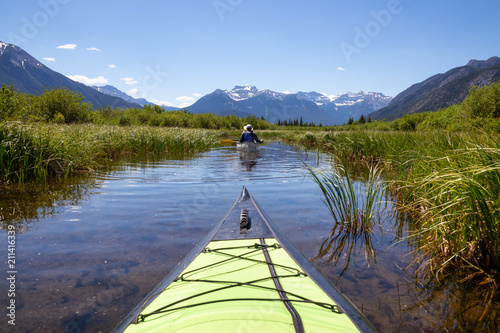 Foto op Aluminium Oceanië Kayaking in a lake surrounded by the Canadian mountains. Taken in Vermilion Lakes, Banff, Alberta, Canada.