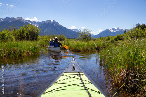 Foto op Aluminium Oceanië Couple adventurous friends are canoeing in a lake surrounded by the Canadian mountains. Taken in Vermilion Lakes, Banff, Alberta, Canada.