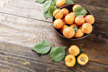 Ripe Apricots On A Wooden Background