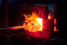 Burning  In A Blacksmith Forge.  Making Metal Items In Smithy. In The Smithy A Red-hot Iron Piece In A Hot Fire Flame Is Ready For Further Processing
