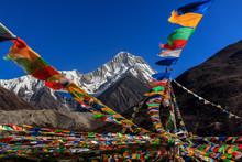 Mount Gongga (also Known As Minya Konka) - Gongga Shan In Sichuan Province, China. Tibetan Prayer Flags With Sacred Snow Mountain In The Background. Himalayas, Highest Mountain In Sichuan Province