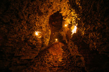 Abandoned And Collapsed Sandstone Or  Limestone Mine Illuminated By Candles