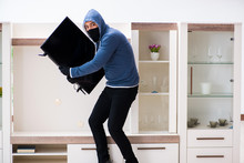 Man Burglar Stealing Tv Set Fr...