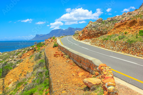 Road trip in summer season alog scenic coastal Route 44 on False Bay near Cape Town between Gordon's Bay and Pringle Bay in Western Cape, South Africa Wallpaper Mural
