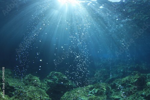 Underwater ocean background with air bubbles in water