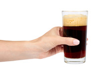 Hand With Cold Glass Of Dark Beer Or Kvass With Foam Isolated On White Background.