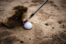 Golfers Are Hitting The Golf Ball By Sand Blasting