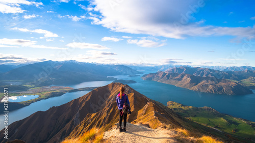 Stickers pour portes Bleu ciel A woman looking at the beautiful landscape of the mountains and Lake Wanaka. Roys Peak Track, South Island, New Zealand.