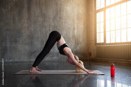 Woman doing yoga exercises in loft studio
