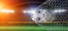 Football Ball In The Net Of A ...
