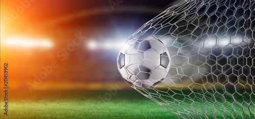 Fototapeta Football ball in the net of a goal - 3d rendering obraz