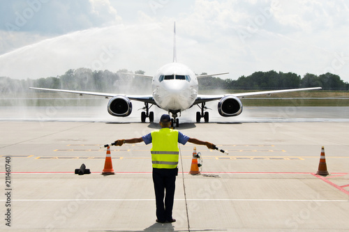Photo  Aircraft under water cannon ground handling