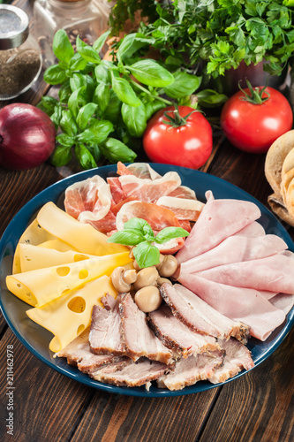 Foto op Canvas Assortiment Cold meat platter with ham, prosciutto, bacon and cheese