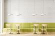 Loft white brick restaurant interior, green sofa