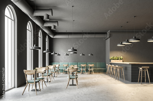 Industrial style cafe interior, green sofas Fototapet