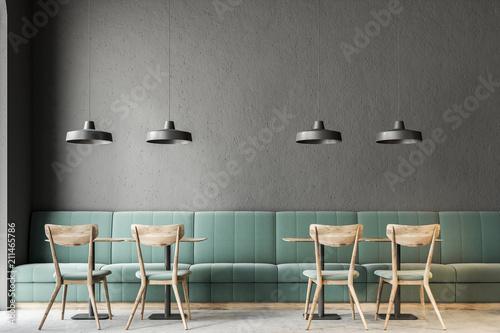 Fotobehang Restaurant Dark gray wall bar interior, green sofas